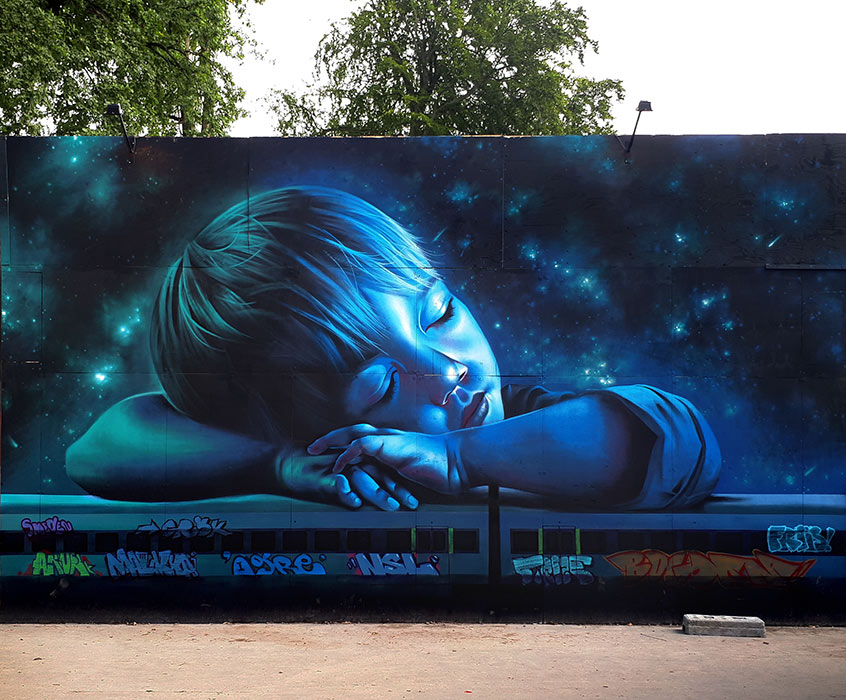 Little boy dreaming on the train, mural at Smukfest 2017